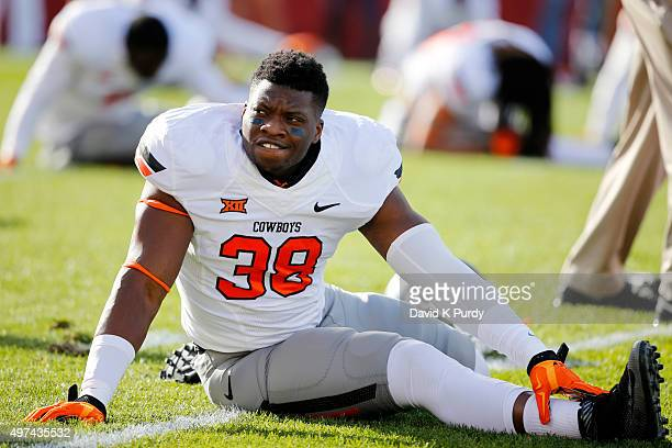 Defensive end Emmanuel Ogbah of the Oklahoma State Cowboys stretches during warms up before game action against the Iowa State Cyclones at Jack Trice...