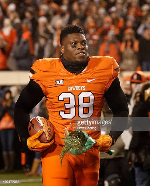 Defensive end Emmanuel Ogbah of the Oklahoma State Cowboys takes the field during Senior Day activities before the game against the Oklahoma Sooners...