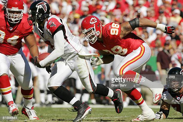 Defensive end Eric Hicks of the Kansas City Chiefs flushes quarterback Michael Vick of the Atlanta Falcons out of the pocket in the first quarter on...