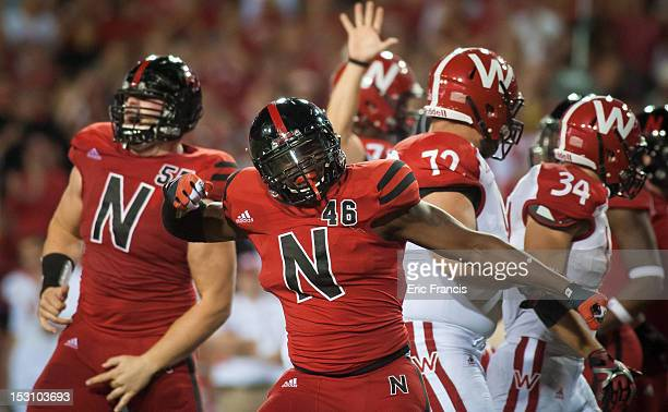 Defensive end Eric Martin of the Nebraska Cornhuskers celebrates a three and out against the Wisconsin Badgers during their game at Memorial Stadium...