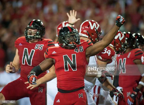 Defensive end Eric Martin of the Nebraska Cornhuskers celebrates a tackle against the Wisconsin Badgers during their game at Memorial Stadium on...