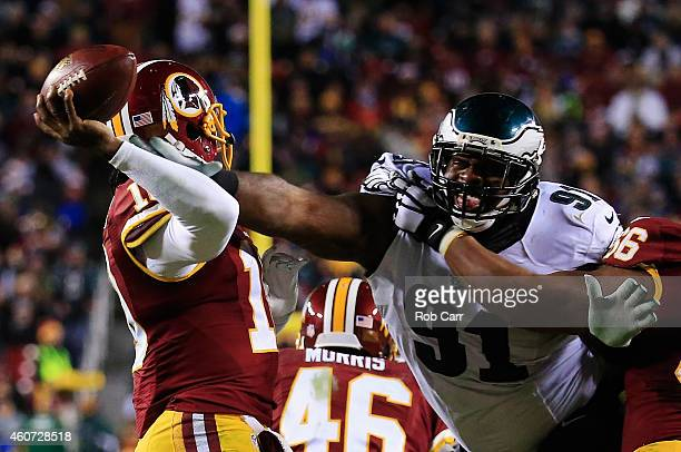 Defensive end Fletcher Cox of the Philadelphia Eagles sacks quarterback Robert Griffin III of the Washington Redskins in the fourth quarter at...