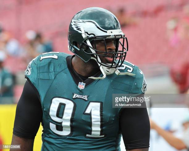 Defensive end Flether Cox of the Philadelphia Eagles warms up for play against the Tampa Bay Buccaneers October 13 2013 at Raymond James Stadium in...