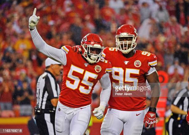 Defensive end Frank Clark of the Kansas City Chiefs celebrates with defensive end Chris Jones, after sacking quarterback Jimmy Garoppolo of the San...