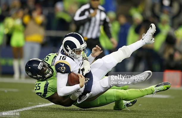 Defensive end Frank Clark of the Seattle Seahawks brings down quarterback Jared Goff of the Los Angeles Rams at CenturyLink Field on December 15 2016...