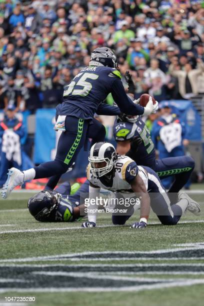 Defensive End Frank Clark of the Seattle Seahawks intercepts the ball in the first quarter against the Los Angeles Rams at CenturyLink Field on...