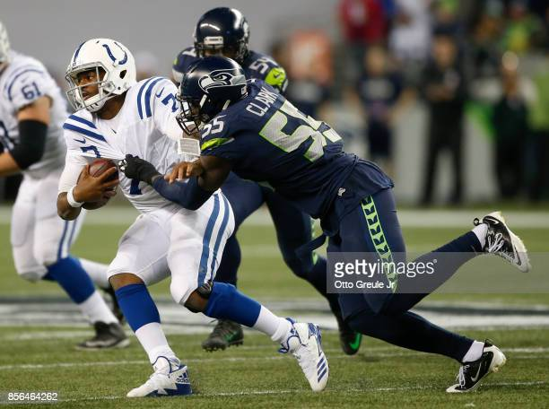 Defensive end Frank Clark of the Seattle Seahawks tackles Jacoby Brissett of the Indianapolis Colts in the fourth quarter of the game at CenturyLink...