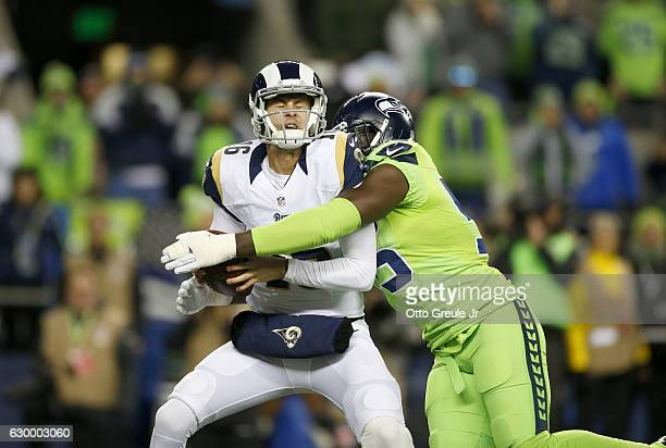 Defensive end Frank Clark of the Seattle Seahawks tackles quarterback Jared Goff against the Los Angeles Rams at CenturyLink Field on December 15...