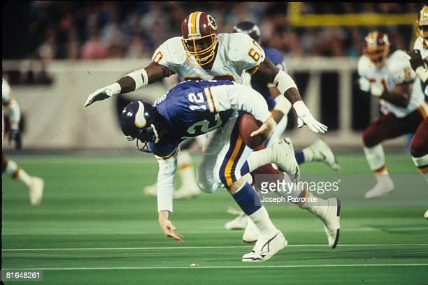 Defensive end Fred Stokes of the Washington Redskins prepares to sack quarterback Sean Salisbury of the Minnesota Vikings in the 1992 NFC Wildcard...