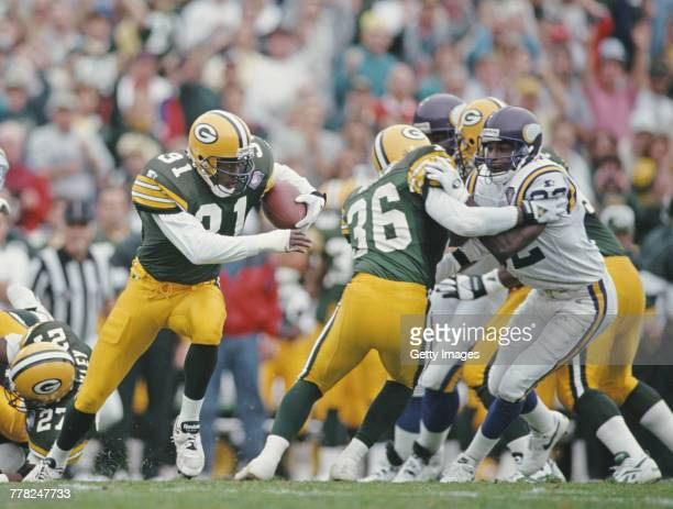 Defensive End George Teague of the Green Bay Packers runs the ball during the National Football Conference Central game against the Minnesota Vikings...