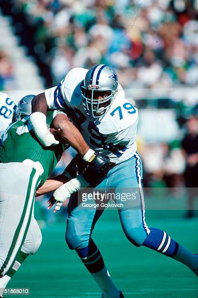 Defensive end Harvey Martin of the Dallas Cowboys blocks in a game against the Philadelphia Eagles on