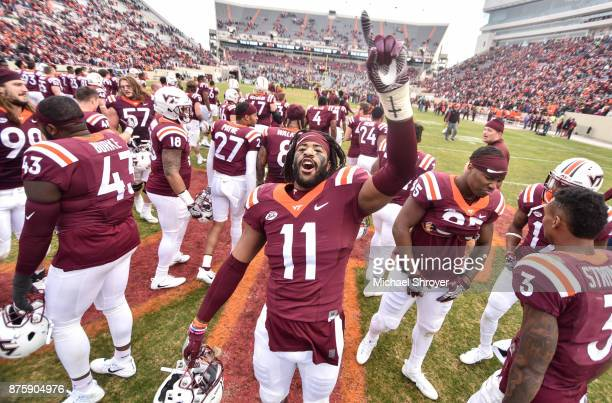 Defensive end Houshun Gaines of the Virginia Tech Hokies sings the fight song following the game against the Pittsburgh Panthers at Lane Stadium on...