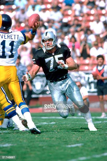 Defensive end Howie Long of the Los Angeles Raiders heads for the quarterback in a 20 to 17 win over the Los Angeles Rams on