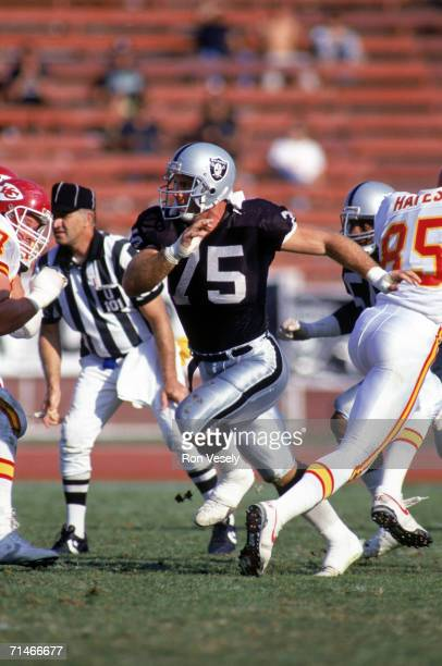 Defensive end Howie Long of the Los Angeles Raiders rushes the passer against the Kansas City Chiefs at the Los Angeles Memorial Coliseum on November...