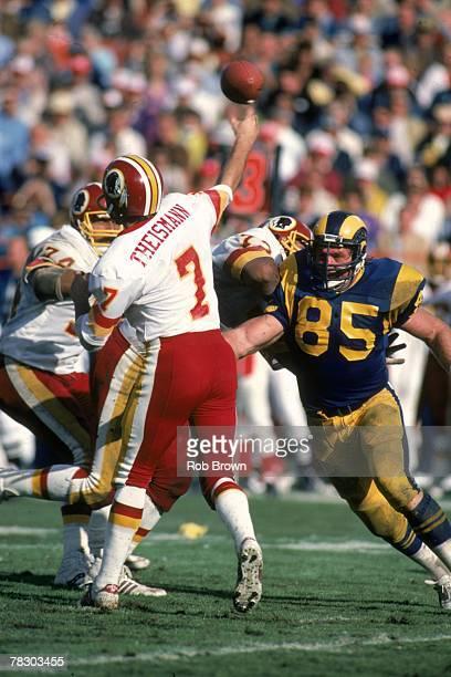 Defensive end Jack Youngblood pressures Washington Redskins quarterback Joe Theismann during a 42-20 loss at Anaheim Stadium on November 20, 1983 in...