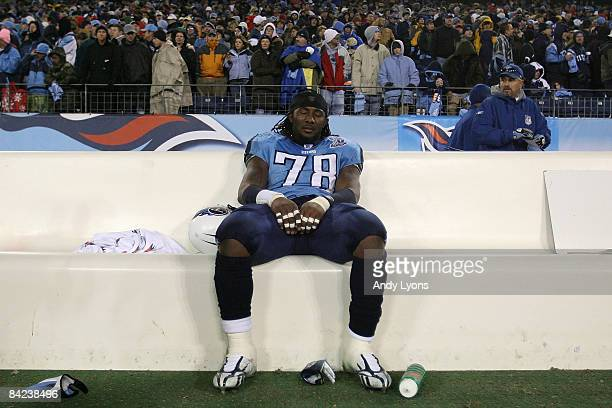 Defensive end Jacob Ford of the Tennessee Titans sits on the bench after losing to the Baltimore Ravens 13-10 during the AFC Divisional Playoff Game...