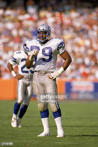 Defensive end Jacob Green of the Seattle Seahawks stands on the field during a game against the Los Angeles Rams in Anaheim Stadium on October 23...