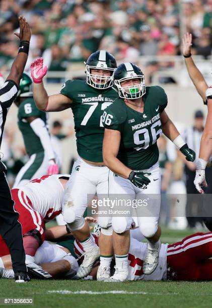 Defensive end Jacub Panasiuk of the Michigan State Spartans celebrates with his brother defensive tackle Mike Panasiuk of the Michigan State Spartans...