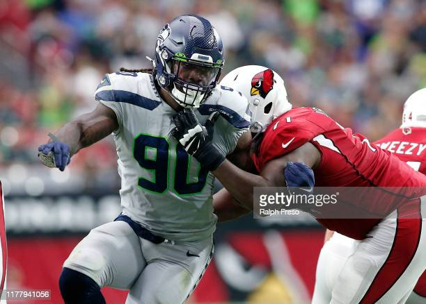 Defensive end Jadeveon Clowney of the Seattle Seahawks battles through the block of offensive lineman Justin Murray of the Arizona Cardinals during...