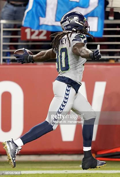 Defensive end Jadeveon Clowney of the Seattle Seahawks recovers a fumble to score a touchdown over the San Francisco 49ers during the second quarter...