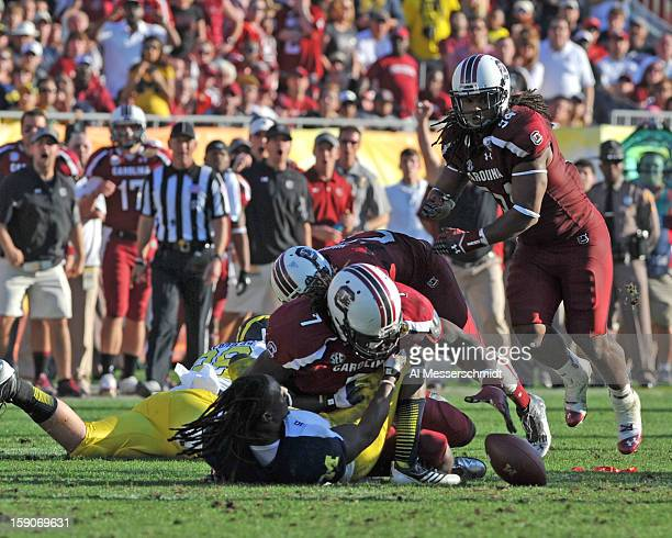 Defensive end Jadeveon Clowney of the South Carolina Gamecocks stretches for a fourthquarter fumble during a 33 28 victory against the Michigan...