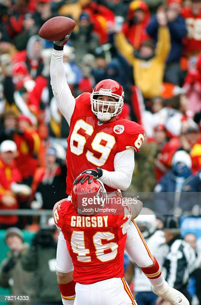 Defensive end Jared Allen of the Kansas City Chiefs celebrates with after a touchdown with fullback Boomer Grigsby in a game against the San Diego...