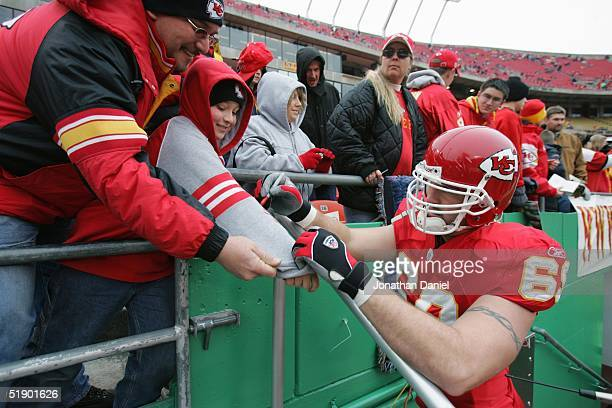 Defensive end Jared Allen of the Kansas City Chiefs signs autographs before facing the San Diego Chargers at Arrowhead Stadium on November 28 2004 in...