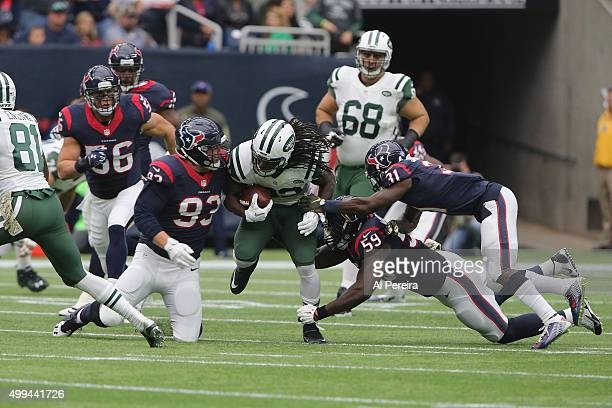 Defensive End Jared Crick Cornerback Charles James and Linebacker Whitney Mercilus of the Houston Texans stop Running Back Chris Ivory of the New...