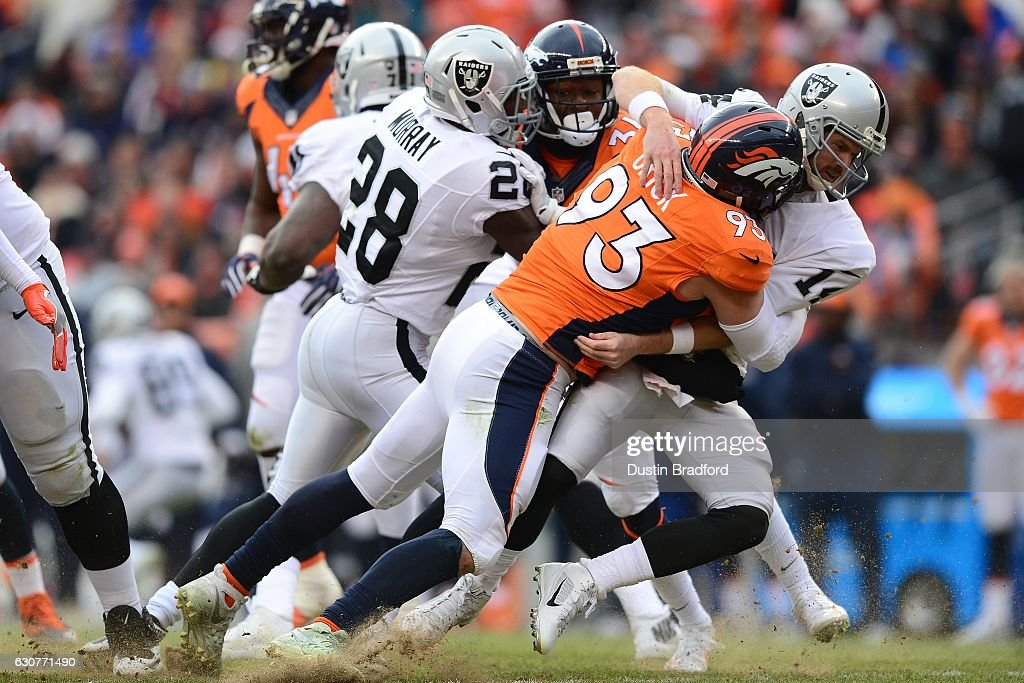 Defensive end Jared Crick #93 of the Denver Broncos was called for a penalty on this play while tackling quarterback Matt McGloin #14 of the Oakland Raiders in the second quarter of the game at Sports Authority Field at Mile High on January 1, 2017 in Denver, Colorado.