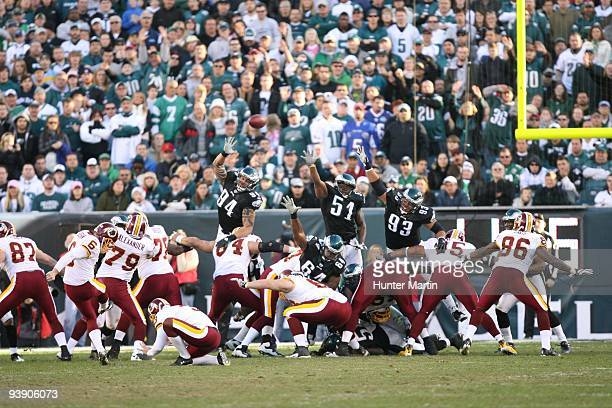 Defensive end Jason Babin linebacker Joe Mays and defensive tackle Trevor Laws of the Philadelphia Eagles attempt to block a field goal during a game...