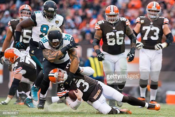 Defensive end Jason Babin of the Jacksonville Jaguars tackles quarterback Brandon Weeden of the Cleveland Browns during the second half at...