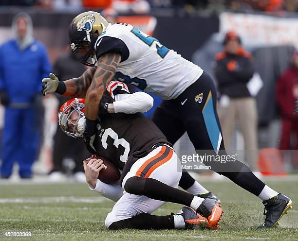 Defensive end Jason Babin of the Jacksonville Jaguars tackles quarterback Brandon Weeden of the Cleveland Browns at FirstEnergy Stadium on December 1...