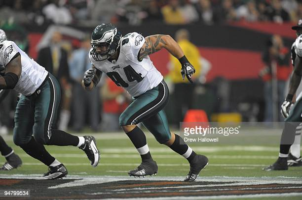 Defensive end Jason Babin of the Philadelphia Eagles comes off the line during the game against the Atlanta Falcons on December 6 2009 at Georgia...
