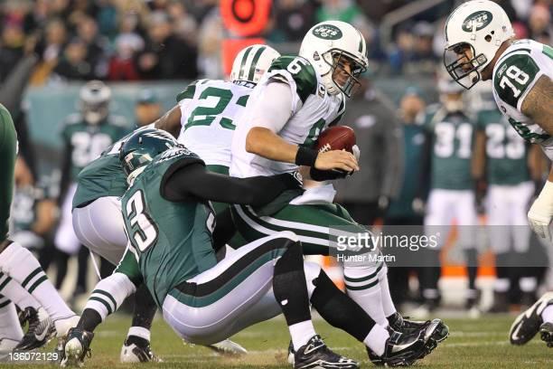 Defensive end Jason Babin of the Philadelphia Eagles sacks quarterback Mark Sanchez of the New York Jets during a game on December 18 2011 at Lincoln...