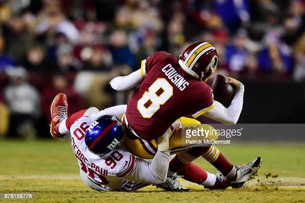 Defensive end Jason PierrePaul of the New York Giants sacks quarterback Kirk Cousins of the Washington Redskins in the fourth quarter at FedExField...