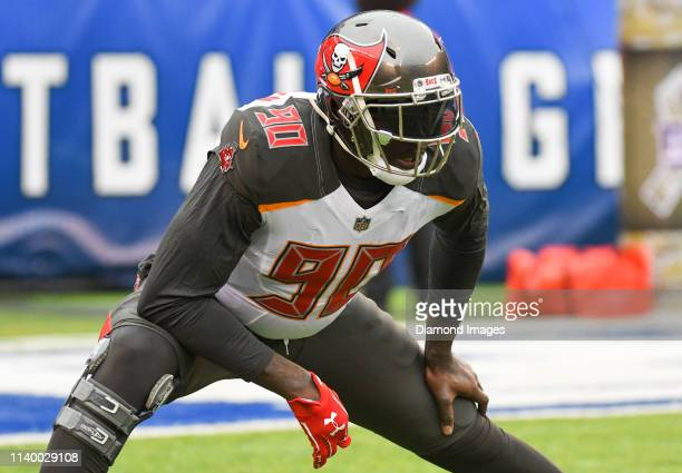 Defensive end Jason PierrePaul of the Tampa Bay Buccaneers stretches prior to a game against the New York Giants on November 18 2018 at MetLife...