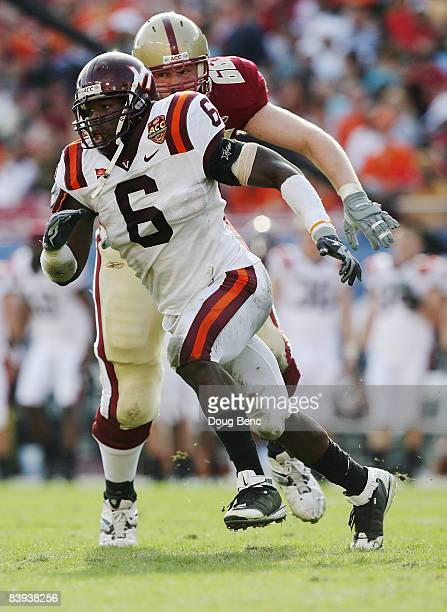 Defensive end Jason Worilds of the Virginia Tech Hokies gets past offensive tackle Rich Lapham of the Boston College Eagles in the 2008 ACC Football...