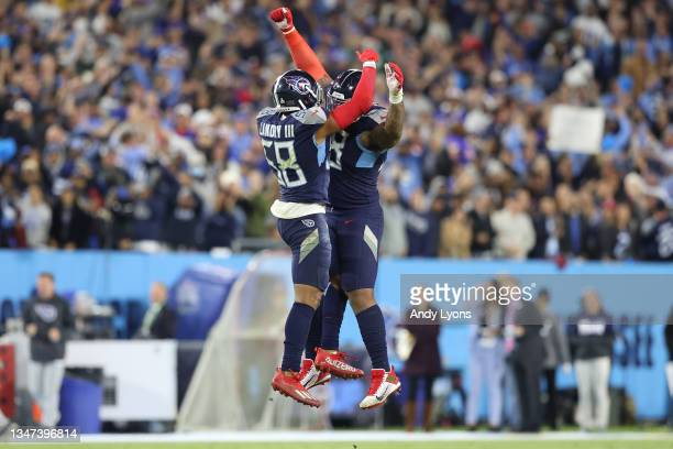 Defensive end Jeffery Simmons and outside linebacker Harold Landry of the Tennessee Titans celebrate after a fourth down stop against the Buffalo...