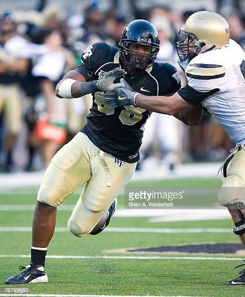 Defensive end Jeremy Thompson of the Wake Forest Demon Deacons tries to rush past tight end Justin Larson of the Army Black Knights during the Demon...