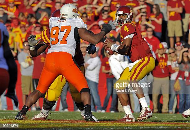 Defensive end Jermiah Price of the Oklahoma State Cowboys puts pressure on quarterback Austen Arnaud of the Iowa State Cyclones in the first half of...