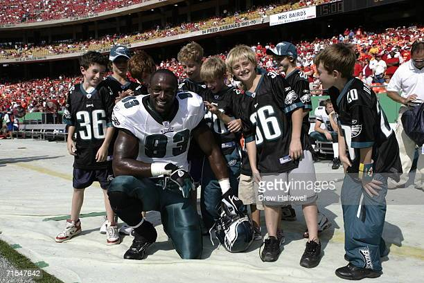 Defensive end Jevon Kearse of the Philadelphia Eagles greets children on the sideline before the game on October 2 2005 at Arrowhead Stadium in...