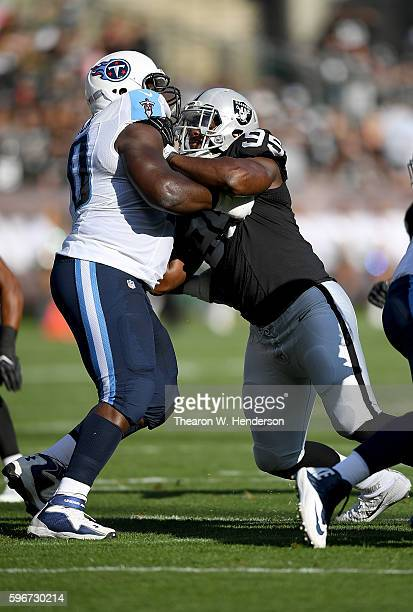 Defensive end Jihad Ward of the Oakland Raiders rushes up against guard Chance Warmack of the Tennessee Titans in the first half of their preseason...