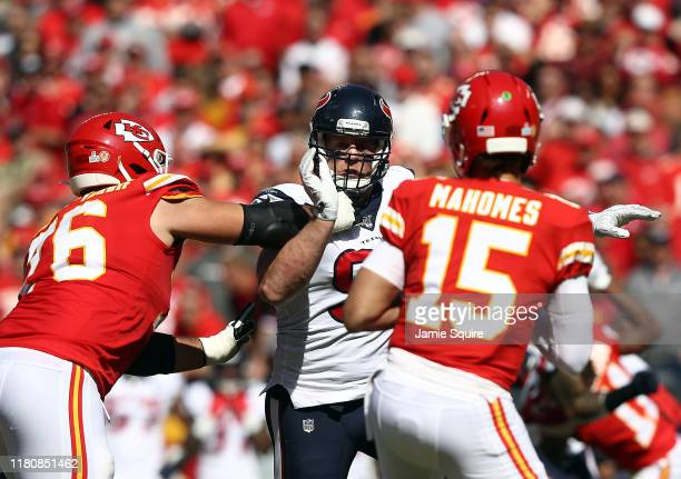 Defensive end JJ Watt of the Houston Texans is blocked by offensive guard Laurent DuvernayTardif as he pursues quarterback Patrick Mahomes during the...