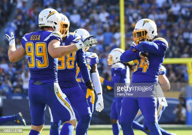 Defensive end Joey Bosa of the Los Angeles Chargers celebrates his sack with defensive end Melvin Ingram in the second quarter against the Arizona...