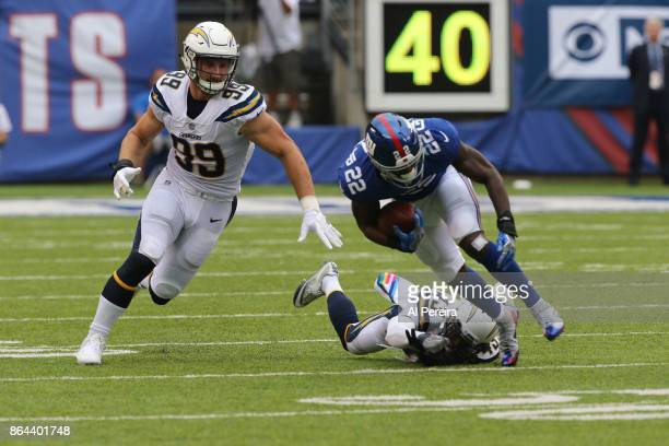 Defensive End Joey Bosa of the Los Angeles Chargers in action against the New York Giants during an NFL game at MetLife Stadium on October 8 2017 in...