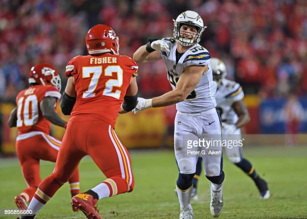 Defensive end Joey Bosa of the Los Angeles Chargers rushes against offensive tackle Eric Fisher of the Kansas City Chiefs at Arrowhead Stadium on...