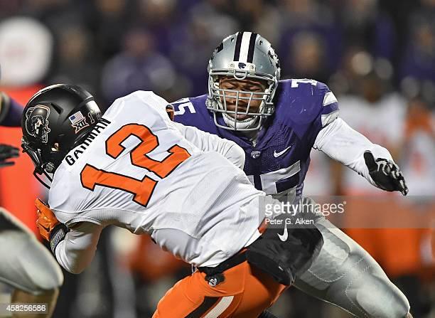 Defensive end Jordan Willis of the Kansas State Wildcats sacks quarterback Daxx Garman of the Oklahoma State Cowboys during the second half on...
