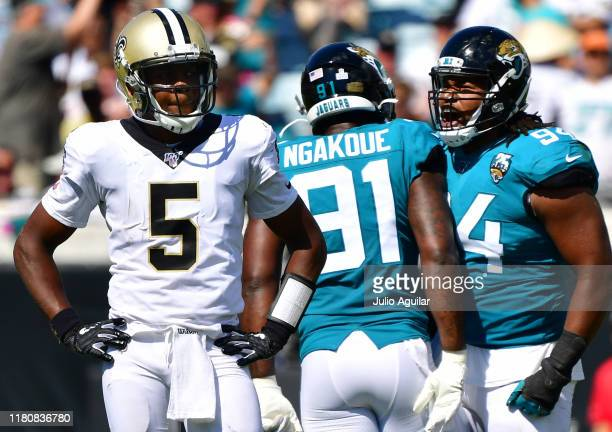 Defensive end Josh Allen of the Jacksonville Jaguars reacts with teammate defensive end Yannick Ngakoue after sacking quarterback Teddy Bridgewater...