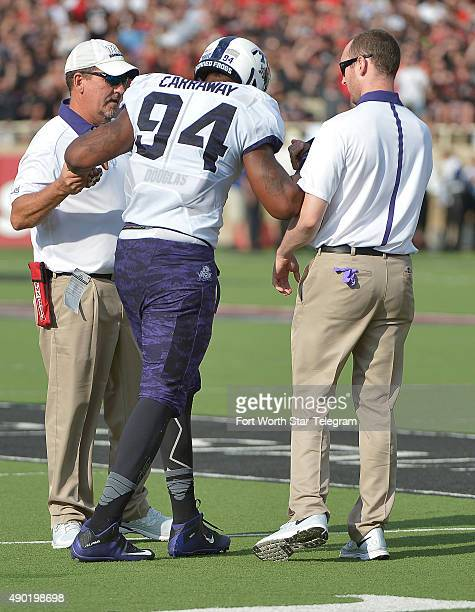 TCU defensive end Josh Carraway is helped off the field during the second quarter against Texas Tech at Jones ATT Stadium in Lubbock Texas on...
