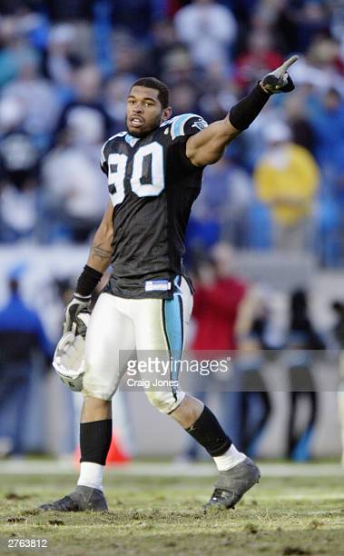Defensive end Julius Peppers of the Carolina Panthers signals during the game against the Tampa Bay Buccaneers on November 9 2003 at Ericsson Stadium...